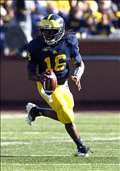September 15, 2012; Ann Arbor, MI, USA; Michigan Wolverines quarterback Denard Robinson (16) rolls out during the second quarter against the Massachusetts Minutemen at Michigan Stadium. Mandatory Credit: Rick Osentoski-US PRESSWIRE