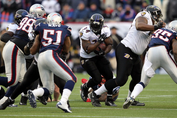 FOXBORO, MA - JANUARY 22:  Ricky Williams #34 of the Baltimore Ravens runs the ball against the New England Patriots during their AFC Championship Game at Gillette Stadium on January 22, 2012 in Foxboro, Massachusetts.  (Photo by Jim Rogash/Getty Images)