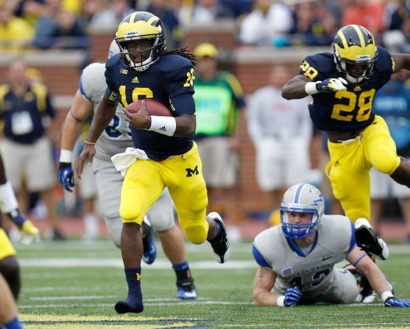 ANN ARBOR, MI - SEPTEMBER 08:  Denard Robinson #16 of the Michigan Wolverines runs for a third quarter touchdown after getting past the tackle of Jared Jones #43 of the Air Force Falcons at Michigan Stadium on September 8, 2012 in Ann Arbor, Michigan. (Photo by Gregory Shamus/Getty Images)