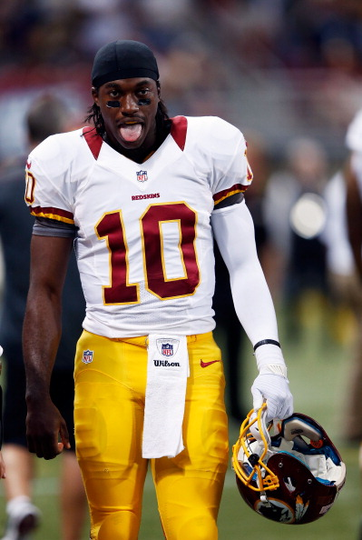 ST LOUIS, MO - SEPTEMBER 16:  Quarterback Robert Griffin III #10 of the Washington Redskins sticksout his tongue on the sidelines during the game against the St. Louis Rams at Edward Jones Dome on September 16, 2012 in St Louis, Missouri.  (Photo by Jamie Squire/Getty Images)