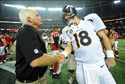 Sep 17, 2012; Atlanta, GA, USA; Atlanta Falcons coach Mike Smith (left) shakes hands with Denver Broncos quarterback Peyton Manning (18) after the game at the Georgia Dome. The Falcons defeated the Broncos 27-21. Mandatory Credit: Kirby Lee/Image of Sport-US PRESSWIRE