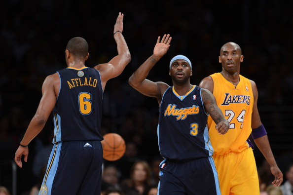 LOS ANGELES, CA - MAY 12:  Arron Afflalo #6 and Ty Lawson #3 of the Denver Nuggets react in the first half alongside Kobe Bryant #24 of the Los Angeles Lakers in Game Seven of the Western Conference Quarterfinals in the 2012 NBA Playoffs on May 12, 2012 at Staples Center in Los Angeles, California. NOTE TO USER: User expressly acknowledges and agrees that, by downloading and or using this photograph, User is consenting to the terms and conditions of the Getty Images License Agreement.  (Photo by Harry How/Getty Images)