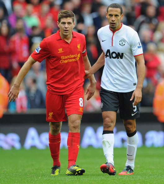 LIVERPOOL, ENGLAND - SEPTEMBER 23: Rio Ferdiand of Manchester United looks on with Steven Gerrard of Liverpool after the Barclays Premier League match between Liverpool and Manchester United at Anfield on September 23, 2012 in Liverpool, England.  (Photo by Michael Regan/Getty Images)