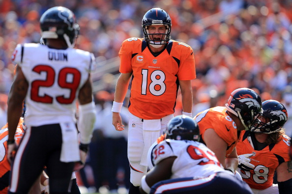 DENVER, CO - SEPTEMBER 23:  Quarterback Peyton Manning #18 of the Denver Broncos runs the offense against the Houston Texans at Sports Authority Field at Mile High on September 23, 2012 in Denver, Colorado. The Texans defeated the Broncos 31-25.  (Photo by Doug Pensinger/Getty Images)