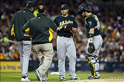 September 19, 2012; Detroit, MI, USA; Oakland Athletics manager Bob Melvin (6), catcher Derek Norris (36) and the trainer check on starting pitcher Brett Anderson (49) after he gets injured during the third inning against the Detroit Tigers at Comerica Park. Mandatory Credit: Rick Osentoski-US PRESSWIRE