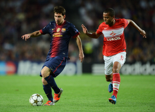 BARCELONA, SPAIN - SEPTEMBER 19:  Lionel Messi (L) of Barcelona duels for the ball with Rafael Carioca of Spartak Moskva during the UEFA Champions League group G match between FC Barcelona and FC Spartak Moscow at the Camp Nou stadium on September 19, 2012 in Barcelona, Spain.  (Photo by Jasper Juinen/Getty Images)