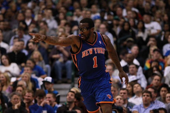 DALLAS, TX - MARCH 06:  Amare Stoudemire #1 of the New York Knicks reacts during play against the Dallas Mavericks at American Airlines Center on March 6, 2012 in Dallas, Texas.  NOTE TO USER: User expressly acknowledges and agrees that, by downloading and or using this photograph, User is consenting to the terms and conditions of the Getty Images License Agreement.  (Photo by Ronald Martinez/Getty Images)