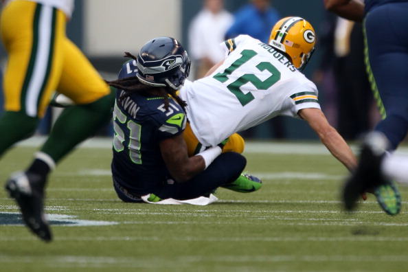 SEATTLE, WA - SEPTEMBER 24:  Bruce Irvin #51 of the Seattle Seahawks sacks quarterback Aaron Rodgers #12 of the Green Bay Packers in the first half at CenturyLink Field on September 24, 2012 in Seattle, Washington.  (Photo by Otto Greule Jr/Getty Images)