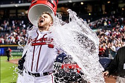 September 25, 2012; Atlanta, GA, USA; Atlanta Braves first baseman Freddie Freeman (5) is dunked after hitting a two-run walk off home run in the ninth inning against the Miami Marlins at Turner Field. The Braves won 4-3 to clinch a playoff berth. Mandatory Credit: Daniel Shirey-US PRESSWIRE