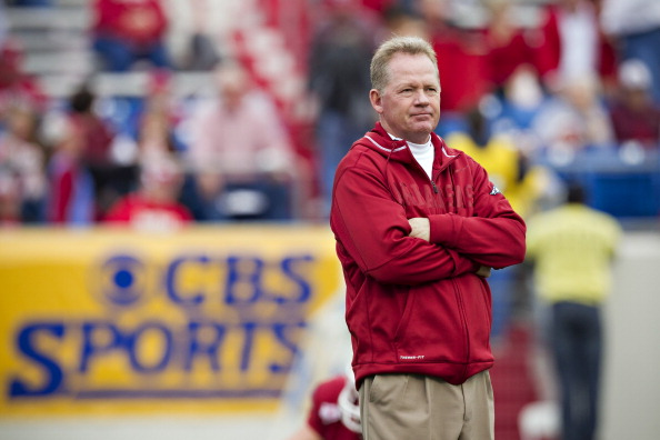 LITTLE ROCK, AR - NOVEMBER 19:   Head Coach Bobby Petrino and the Arkansas Razorbacks watches his team warm up before a game against the Mississippi State Bulldogs at War Memorial Stadium on November 19, 2011 in Little Rock, Arkansas. The Razorbacks defeated the Bulldogs 44-17.  (Photo by Wesley Hitt/Getty Images)
