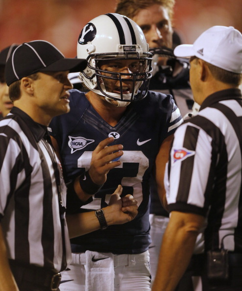 SALT LAKE CITY, UT - SEPTEMBER 15: Quarterback for the BYU Cougars Riley Nielson #13  talks to officials during a game against the University of Utah Utes during the second half of an college football game September 15, 2012 at Rice Eccles Stadium in Salt Lake City, Utah. Utah beat BYU 24-21. (Photo by George Frey/Getty Images)
