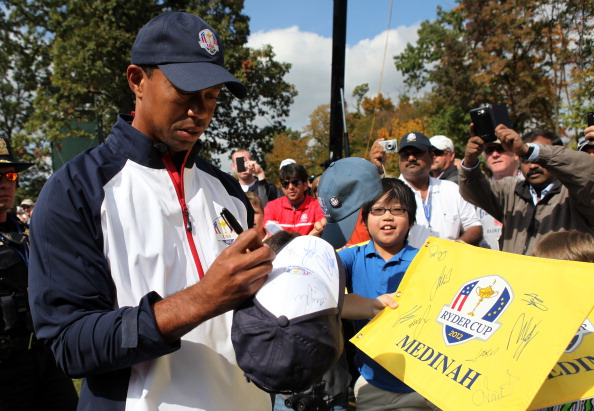 MEDINAH, IL - SEPTEMBER 27:  Tiger Woods of the USA signs autographs for fans during a practice round during the fourth preview day of The 39th Ryder Cup at Medinah Country Club on September 27, 2012 in Medinah, Illinois.  (Photo by Jamie Squire/Getty Images)