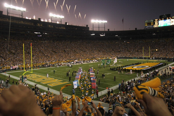 GREEN BAY, WI - SEPTEMBER 08:  Fans cheer during player introductions as the Green Bay Packers take the field  before the NFL opening season game against the New Orleans Saints at Lambeau Field on September 8, 2011 in Green Bay, Wisconsin. The Packers defeated the Saints 42-34.  (Photo by Jonathan Daniel/Getty Images)