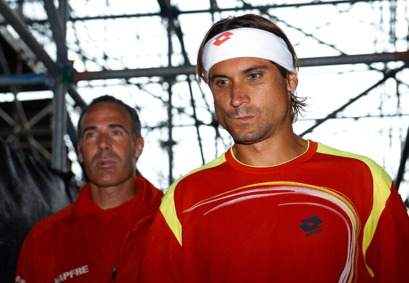 GIJON, SPAIN - SEPTEMBER 16:  David Ferrer (R) of Spain and team captain Alex Corretja walk to the court before day three of the semi final Davis Cup between Spain and the United States at the Parque Hermanos Castro on September 16, 2012 in Gijon, Spain.  (Photo by Manuel Queimadelos Alonso/Getty Images)