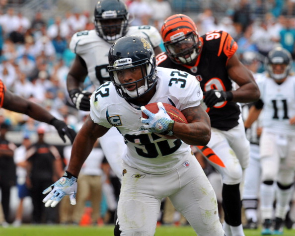 JACKSONVILLE, FL - OCTOBER 9:  Running back Maurice Jones-Drew #32 of the Jacksonville Jaguars runs for a first-quarter,  six-yard touchdown against the Cincinnati Bengals October 9, 2011 at EverBank Field in Jacksonville, Florida. (Photo by Al Messerschmidt/Getty Images)