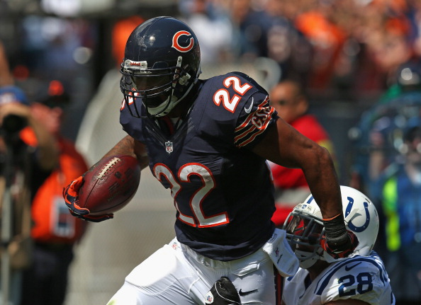 CHICAGO, IL - SEPTEMBER 09:  Matt Forte #22 of the Chicago Bears tries to break away from Tom Zbikowski #28 of the Indianapolis Colts during their 2012 NFL season opener at Soldier Field on September 9, 2012 in Chicago, Illinois. The Bears defeated the Colts 41-21.  (Photo by Jonathan Daniel/Getty Images)