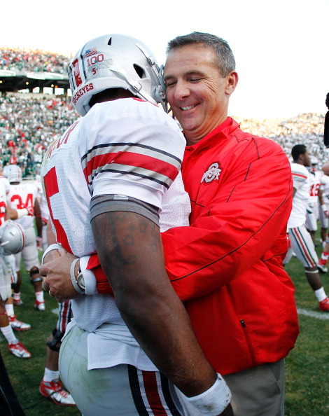 EAST LANSING, MI - SEPTEMBER 29:  Head coach Urban Meyer of the Ohio State Buckeyes celebrates with Braxton Miller #5 after beating the Michigan State Spartans 17-16 at Spartan Stadium on September 29, 2012 in East Lansing, Michigan. (Photo by Gregory Shamus/Getty Images)
