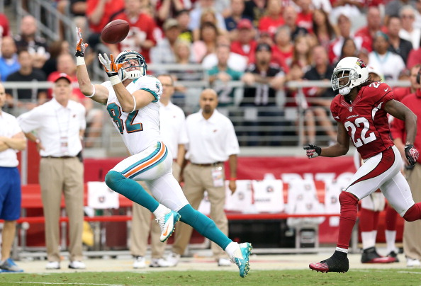 GLENDALE, AZ - SEPTEMBER 30:  Wide receiver Brian Hartline #82 of the Miami Dolphins catches a 57 yard reception past cornerback William Gay #22 of the Arizona Cardinals during the second quarter of the NFL game at the University of Phoenix Stadium on September 30, 2012 in Glendale, Arizona.  (Photo by Christian Petersen/Getty Images)