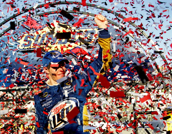 DOVER, DE - SEPTEMBER 30:  Brad Keselowski, driver of the #2 Miller Lite Dodge, celebrates in Victory Lane after winning the NASCAR Sprint Cup Series AAA 400 at Dover International Speedway on September 30, 2012 in Dover, Delaware.  (Photo by Jerry Markland/Getty Images for NASCAR)