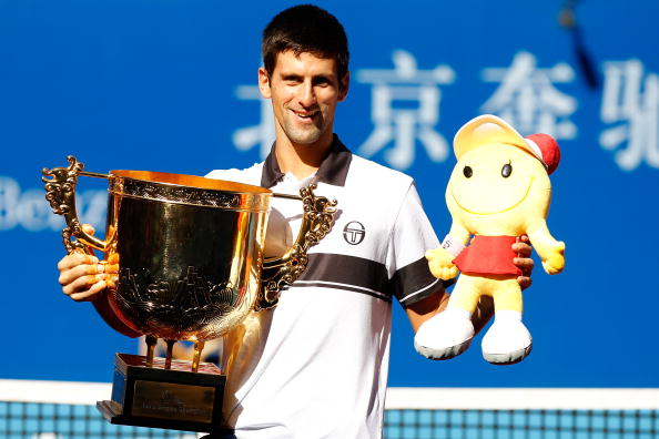 BEIJING - OCTOBER 11:  Novak Djokovic of Serbia poses for photographers after defeating David Ferrer of Spain during the final on day eleven of the 2010 China Open at the National Tennis Center on October 11, 2010 in Beijing, China.  (Photo by Matthew Stockman/Getty Images)