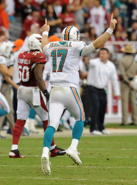 GLENDALE, AZ - SEPTEMBER 30:  Ryan Tannehill #17 of the Miami Dolphins celebrates throwing a touchdown against the Arizona Cardinals at University of Phoenix Stadium on September 30, 2012 in Glendale, Arizona.  (Photo by Norm Hall/Getty Images)