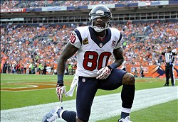 September 23 2012; Denver, CO, USA; Houston Texans wide receiver Andre Johnson (80) reacts after dropping a pass during the third quarter of the game against the Denver Broncos at Sports Authority Field. The Texans defeated the Broncos 31-25. Mandatory Credit: Ron Chenoy-US PRESSWIRE