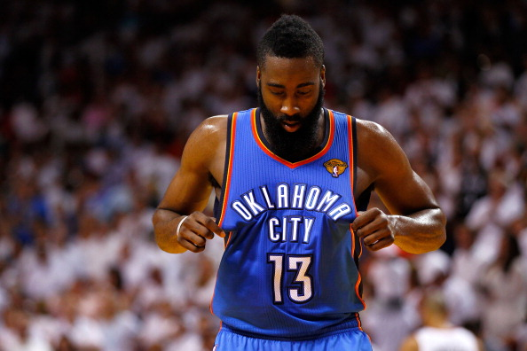MIAMI, FL - JUNE 17:  James Harden #13 of the Oklahoma City Thunder stands on court with his head down in the second half against the Miami Heat in Game Three of the 2012 NBA Finals on June 17, 2012 at American Airlines Arena in Miami, Florida.  NOTE TO USER: User expressly acknowledges and agrees that, by downloading and or using this photograph, User is consenting to the terms and conditions of the Getty Images License Agreement.  (Photo by Mike Ehrmann/Getty Images)