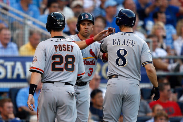 KANSAS CITY, MO - JULY 10:  National League All-Stars Buster Posey #28 of the San Francisco Giants, Carlos Beltran #3 of the St. Louis Cardinals and Ryan Braun #8 of the Milwaukee Brewers score on a three-run triple by Pablo Sandoval #48 of the San Francisco Giants in the first inning during the 83rd MLB All-Star Game at Kauffman Stadium on July 10, 2012 in Kansas City, Missouri.  (Photo by Jamie Squire/Getty Images)