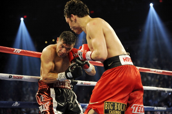 LAS VEGAS, NV - SEPTEMBER 15:  Julio Cesar Chavez Jr. (R) lands a right to the head of Sergio Martinez in the seventh round of their WBC middleweight title fight at the Thomas & Mack Center on September 15, 2012 in Las Vegas, Nevada.  (Photo by Jeff Bottari/Getty Images)