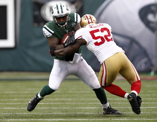 EAST RUTHERFORD, NJ - SEPTEMBER 30:  Patrick Willis #52 of the San Francisco 49ers takes down  Jeff Cumberland #86 of the New York Jets  during a game at MetLife Stadium on September 30, 2012 in East Rutherford, New Jersey.  (Photo by Jeff Zelevansky/Getty Images)