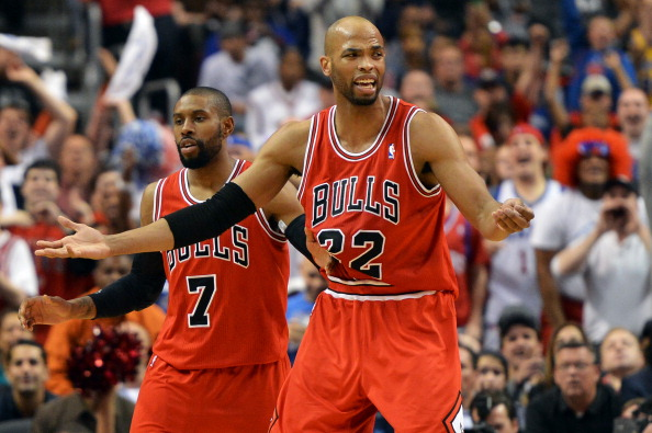 PHILADELPHIA, PA - MAY 10: Taj Gibson #22 and C.J. Watson #7 of the Chicago Bulls react to a technical foul during the game against the Philadelphia 76ers in Game Six of the Eastern Conference Quarterfinals in the 2012 NBA Playoffs at the Wells Fargo Center on May 10, 2012 in Philadelphia, Pennsylvania. NOTE TO USER: User expressly acknowledges and agrees that, by downloading and or using this photograph, User is consenting to the terms and conditions of the Getty Images License Agreement. (Photo by Drew Hallowell/Getty Images)