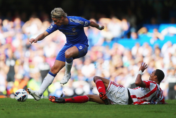 LONDON, ENGLAND - SEPTEMBER 22:  Fernando Torres of Chelsea evades Steven N'Zonzi of Stoke City during the Barclays Premier League match between Chelsea and Stoke City at Stamford Bridge on September 22, 2012 in London, England.  (Photo by Clive Rose/Getty Images)