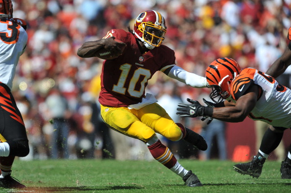 LANDOVER, MD - SEPTEMBER 23: Robert Griffen III #10 of the Washington Redskins runs the ball against the Cincinnati Bengals at FedExField on September 23, 2012 in Landover, Maryland. The Bengals defeated the Redskins 38-31. (Photo by Larry French/Getty Images)