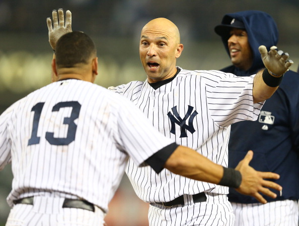 NEW YORK, NY - OCTOBER 02:  Raul Ibanez #27 of the New York Yankees celebrates with Alex Rodriguez #13 after hitting a walk-off single against the Boston Red Sox  in the twelfth inning to win the game 4-3  on October 2, 2012 at Yankee Stadium in the Bronx borough of New York City  (Photo by Al Bello/Getty Images)