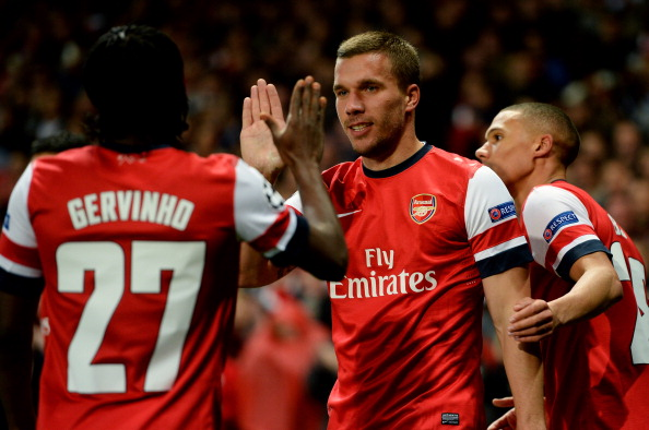 LONDON, ENGLAND - OCTOBER 03:  Lukas Podolski of Arsenal celebrates with teammate Gervinho after scoring his team's second goal during the UEFA Champions League Group B match between Arsenal FC and Olympiacos FC at Emirates Stadium on October 03, 2012 in London, England.  (Photo by Mike Hewitt/Getty Images)