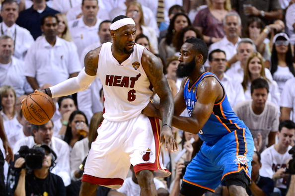 MIAMI, FL - JUNE 21:  LeBron James #6 of the Miami Heat looks to pass against James Harden #13 of the Oklahoma City Thunder in Game Five of the 2012 NBA Finals on June 21, 2012 at American Airlines Arena in Miami, Florida. NOTE TO USER: User expressly acknowledges and agrees that, by downloading and or using this photograph, User is consenting to the terms and conditions of the Getty Images License Agreement.  (Photo by Ronald Martinez/Getty Images)