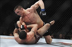 Feb 15, 2012; Omaha, NE, USA; Jake Ellenberger (top) fights with Diego Sanchez in the Main Event during UFC on Fuel TV 1 at Omaha Civic Auditorium. Mandatory Credit: Matt Ryerson-US PRESSWIRE