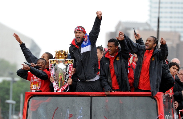 MANCHESTER, ENGLAND - MAY 30:  Rio Ferdinand (C) of Manchester United celebrates with the trophy during the Manchester United Premier League Winners Parade at Old Trafford on May 30, 2011 in Manchester, United Kingdom.  (Photo by Chris Brunskill/Getty Images)