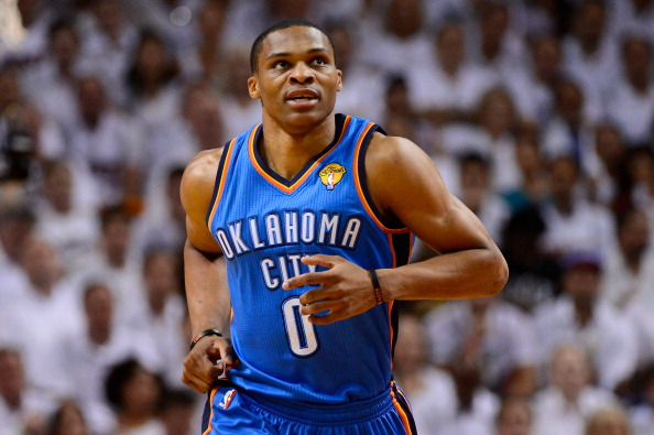 MIAMI, FL - JUNE 21:  Russell Westbrook #0 of the Oklahoma City Thunder runs up court against the Miami Heat in Game Five of the 2012 NBA Finals on June 21, 2012 at American Airlines Arena in Miami, Florida. NOTE TO USER: User expressly acknowledges and agrees that, by downloading and or using this photograph, User is consenting to the terms and conditions of the Getty Images License Agreement.  (Photo by Ronald Martinez/Getty Images)