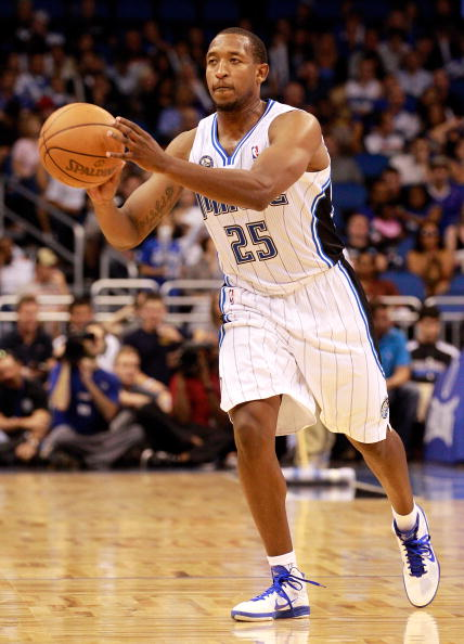 ORLANDO, FL - OCTOBER 10:  Chris Duhon #25 of the Orlando Magic passes the ball during the game against the New Orleans Hornets at Amway Arena on October 10, 2010 in Orlando, Florida. NOTE TO USER: User expressly acknowledges and agrees that, by downloading and or using this Photograph, user is consenting to the terms and conditions of the Getty Images License Agreement.  (Photo by Sam Greenwood/Getty Images)