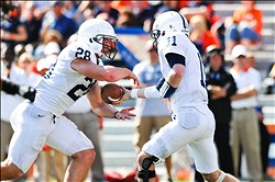 Sep 29, 2012; Champaign, IL, USA; Penn State Nittany Lions quarterback Matthew McGloin (11) hands the ball off to running back Zach Zwinak (28) during the third quarter against the Illinois Fighting Illini at Memorial Stadium. Mandatory Credit: Bradley Leeb-US PRESSWIRE