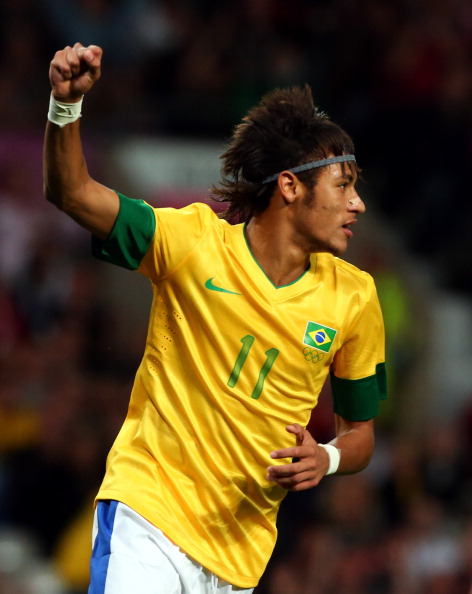 MANCHESTER, ENGLAND - AUGUST 07: Neymar of Brazil celebrates after Leandro Damiao scored the 2nd goal against Korea during the Men's Football Semi Final match between Korea and Brazil, on Day 11 of the London 2012 Olympic Games at Old Trafford on August 7, 2012 in Manchester, England.  (Photo by Stanley Chou/Getty Images)