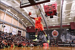 Mar 26, 2012; Chicago, IL, USA; McDonalds High School All American forward Alex Poythress (22) does a dunk in the slam dunk contest during Jam Fest at the Gerald Ratner Athletic Center for the 35th McDonalds All American Game.  Mandatory Credit: Brian Spurlock-US PRESSWIRE