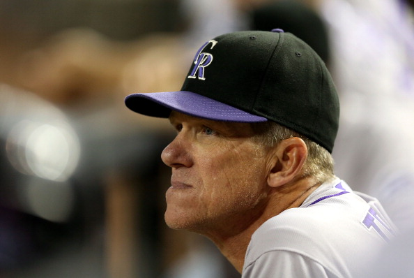 PHOENIX, AZ - OCTOBER 02:  Manager Jim Tracy of the Colorado Rockies watches from the dugout during the MLB game against the Arizona Diamondbacks at Chase Field on October 2, 2012 in Phoenix, Arizona. The Diamondbacks defeated the Rockies 5-3. (Photo by Christian Petersen/Getty Images)