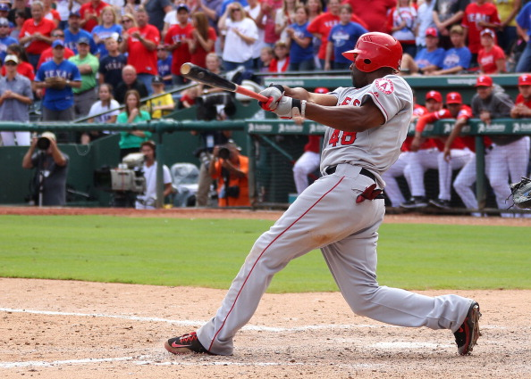 ARLINGTON, TX - SEPTEMBER 30: Torii Hunter #48 of the Los Angeles Angels of Anaheim hits a two run double to take the lead against the Texas Rangers in game one of the double header at Rangers Ballpark in Arlington on September 30, 2012 in Arlington, Texas.  (Photo by Rick Yeatts/Getty Images)