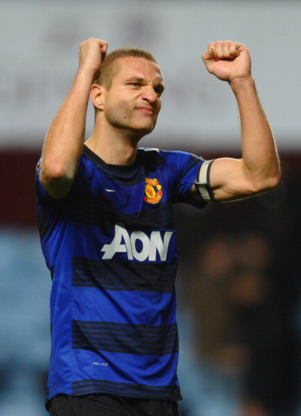 BIRMINGHAM, ENGLAND - DECEMBER 03: Nemanja Vidic of Manchester United celebrates victory at the final whistle during the Barclays Premier League match between Aston Villa and Manchester United at Villa Park on December 3, 2011 in Birmingham, England.  (Photo by Laurence Griffiths/Getty Images)