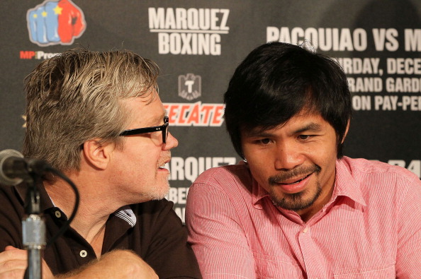 BEVERLY HILLS, CA - SEPTEMBER 17:  (L-R) Trainer Freddie Roach and boxer Manny Pacquiao share a few words during the Manny Pacquiao v Juan Manuel Marquez - Press Conference at Beverly Hills Hotel on September 17, 2012 in Beverly Hills, California.  (Photo by Victor Decolongon/Getty Images)