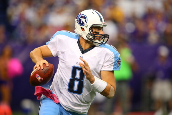 MINNEAPOLIS, MN - OCTOBER 7:    Matt Hasselbeck #8 of the Tennessee Titans rolls out of the pocket against the Minnesota Vikings at the Hubert H. Humphrey Metrodome on October 7, 2012 in Minneapolis, Minnesota.  (Photo by Adam Bettcher/Getty Images)