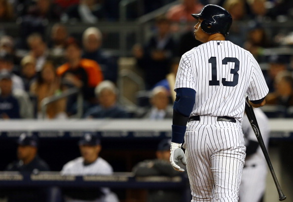 NEW YORK, NY - OCTOBER 10: Alex Rodriguez #13 of the New York Yankees looks on after striking out against the Baltimore Orioles  during Game Three of the American League Division Series at Yankee Stadium on October 10, 2012 in the Bronx borough of New York City.  (Photo by Elsa/Getty Images)