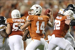 Oct 6, 2012; Austin, TX, USA; Texas Longhorns quarterback David Ash (14) throws a pass during the second quarter against the West Virginia Mountaineers at Darrell K Royal-Texas Memorial Stadium. Mandatory Credit: Tim Heitman-US PRESSWIRE